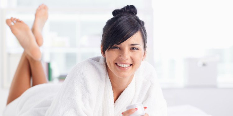 Pretty young woman in bathrobe looking at camera